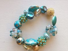 Have you tried the Boho Bauble Bracelet yet? Heather Kuhns of Mosaic Interactive has! Check out her gorgeous designs, love the look Heather!  You can make a beautiful bracelet like this also! Check out our how-to blog for details -- http://jessejamesbeads.blogspot.com/2013/08/jewelry-tutorial-boho-bauble-bracelet.html