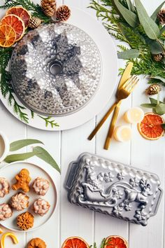 Create a magical dessert display on your holiday table with our Holiday Baking Pans. A snow-capped Pine Tree Bundt, Santa Sleigh Loaf, and Holiday tea cakes make a sweet assortment.