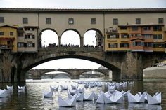 paper boats in Arno Rover, Florence, Italy- playingwithbooks.com