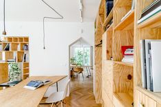 Another Studio replaces walls with storage to transform apartment into own workspace