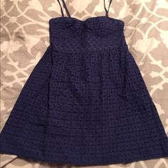 American Eagle Navy Dress Never worn without tags, navy blue lacy dress. Knee-length, dress has straps and can be removed for a strapless look. American Eagle Outfitters Dresses Mini