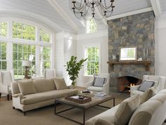 Stone Fireplace & Wall of Windows