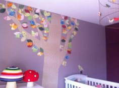Wonderland Kids Concept Store, Wallpaper tree by Inke and crochet mushroom poufs by Anne-Claire Petit.