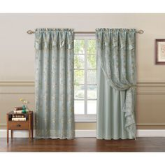 Dress your windows with the Charlize Embroidered Curtain Panel. This beautiful curtain features an embroidered floral design and has a double valance and backing attached.
