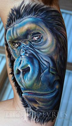 fuckyeahqualitytattoos:  Alright, last one for now, i gotta go to the hospital to get my broken nose checked out; Gorilla done by Mike Devries