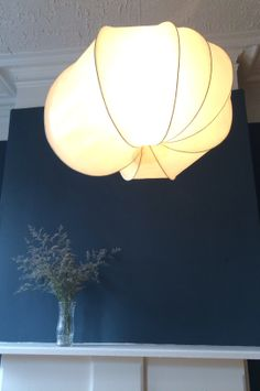 Tomatillo.  Steel, kozo paper, beeswax and resin. http://www.leantolights.com/tomatillo/