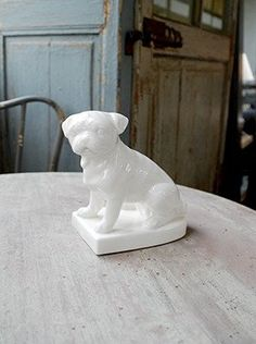 "Pug on Base Statuette: White Porcelain. Dimensions: 7.2"" x 4"" x 5.5"""