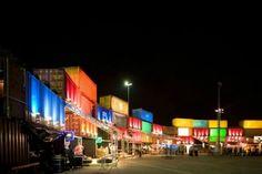 Illuminated shipping container wall is a temporary music festival venue in Rio de Janeiro