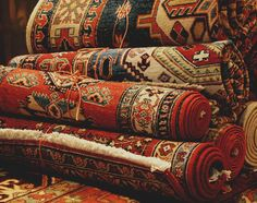 rolled up colorful rugs