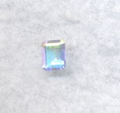 Ugh, so I keep changing my mind. I came across mercury mist topaz again and it's just too perfect to resist. It has all the qualities of rainbow moonstone but more. It has more colors, it's always colorful instead of just in the light, and it's a lot stronger. It's also cheaper because topaz is very common. Not sure what cut I want though. I'm showing this stone because it's very pretty.