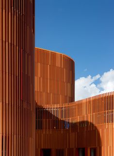 Vertical strips of masonry wrap around the buildings and playgrounds that make up this kindergarten.