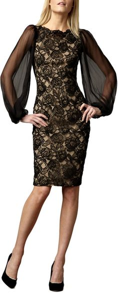 Very nice and pretty nude and black laced cocktail dress with sheer over-sized billowing sleeves.