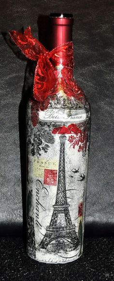 DIY...Take an old wine bottle or any bottle will do. Print out a printable photo, graphic or picture of your choice. Make sure the bottle is clean. Next check the length of your paper and make sure you cut to fit. Take Mod Podge, apply to bottle, apply the paper, apply Mod Podge again. Make sure all areas are covered. Let Dry, then apply ribbon to the top....done