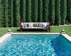 Martyn Lawrence-Bullard designed the sofa by the pool.