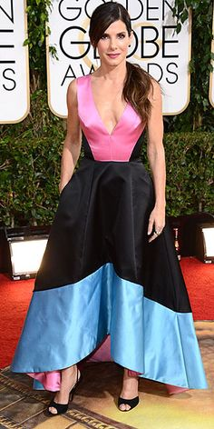 Sandra Bullock's Style Evolution | TAKING THE PLUNGE   | Nominated for her role in Gravity, she hit the 2014 Golden Globes in a color-block Prabal Gurung gown with a high-low hemline (that, might we add, gave her gravity-defying cleavage). Still, her side-parted low ponytail managed to steal the spotlight.