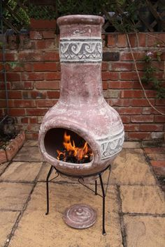 Large clay chimenea with a wave pattern. This large size chimenea is for us as a patio heater, it comes complete with lid, only for use as a rain lid - not when the fire is in use. The chimenea also comes complete with steel stand.Clay chimeneas have been used in Central America for centuries and do not need large fires, they heat up quickly and retain their heat for a long while afterwards with only a small fire.These chimeneas are hand made and hand painted and therefore designs…