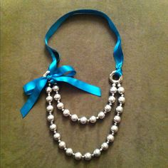 silver bead necklace with teal ribbon... yup, I made it :)