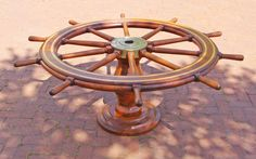 This authentic WWII era naval ship's wheel is the perfect maritime artifact to create an exceptional coffee or dining Table. Nautical antiques, furniture, coffee table, coastal home, Coastal Living Rooms, Coastal Homes, Coastal Decor, Nautical Furniture, Home Decor Furniture, Table Furniture, Nautical Coffee Table, Wine Barrel Crafts, Hatch Cover