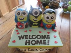 A welcome home cake for my own personal minions, Captain 'Azia' America, 'Babbo' Batman and Superman 'Sam' ! (lemon drizzle & choc biscuit cake)