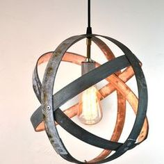 Salvaged wine barrel straps made into light fixture