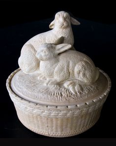 A charming french beige-colored pottery basket-weave bowl with cover adorned with two rabbits on the domed lid, with one seated and one standing with inquisitive gazes; minor wear; excellent condition. Late 19th century. $2,200.00. From @epocasf