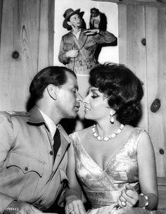 Medium BTS shot of Frank Sinatra as Capt. Tom Reynolds about to kiss Gina Lollobrigida as Carla Vesari.