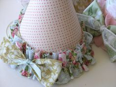 What a cute idea - make your own party hats with cardstock and a piece of fabric ... A great way to get the exact custom hat you want, and a great way to use up old paper party hats!