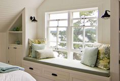 Sullivan Island - This custom made window seat is a lovely spot to sit and read. The built in nooks on either side take advantage of the sloping roof to create to some additional storage space.