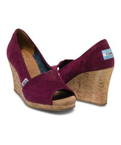 The perfect sunny-weather shoe with all the perks TOMS has to offer. The cork-wrapped wedge heel is lined with a comfortable suede insole, while the rubber sole provides additional cushion. And with the purchase of every pair of TOMS shoes, another pair is given to a child in need somewhere in the world. Size note: TOMS run true to size. If you're typically in-between sizes, TOMS recommends ordering smaller since TOMS shoes will stretch with wear.
