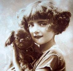 ... French photo postcard, girl with toy dog / pekingese dog, ca 1920