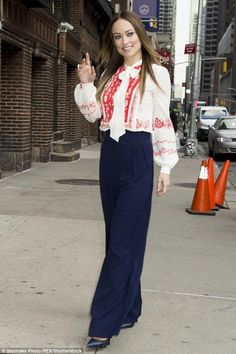 Olivia Wilde wearing Parker Eldora Pants in Petrol and Casadei Navy Blue Python Blade Pumps