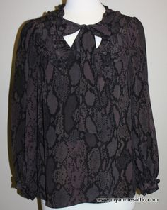 Rebecca Taylor long-sleeve blouse, size 6 Black and brown snake print; 100% silk Elasticized sleeves at wrist, neck tie 2 small buttons at chest, pulls on over head $35.90
