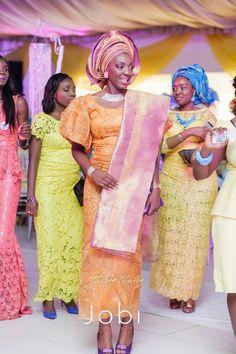 Toyin & Pastor Poju Oyemade | BellaNaija Weddings February 2015 | Yoruba Wedding in Lagos, Nigeria._orange and purple gele bride.