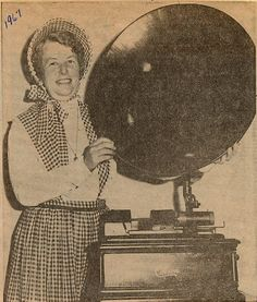 Mrs Jim Harris displaying Victrola c1890 at 1967 Altona Women's Institute Centennial Antique show. Courtesy of Pickering Library