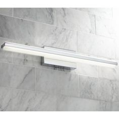 """In a clean, minimalist style this sleek linear LED bath light features a chrome finish. 31 1/4"""" wide x 4 1/2"""" high. Backplate is 9 1/4"""" wide x 4 1/2"""" high. Extends only 3 3/4"""" from the wall, ADA compliant. 15 watt built-in dimmable LEDs. Comparable to a 100 watt incandescent bulb. 1800 lumens. 3000K. Style # 7K874 at Lamps Plus."""
