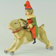 Bisque head girl riding a rabbit