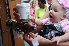 Genevieve Bennett, 4 months, frpm Shippensburg checks out bracelets