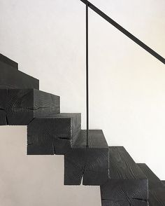 Black stained timbre stair treads with thin black railing