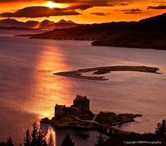Skye sunset - Sun sets over the Cuillins of Skye with Eilean Donan Castle in the foreground.
