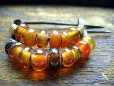Iron Age beaded amber fibulae (reproduction)