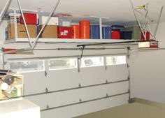 More garage organization with hanging shelves