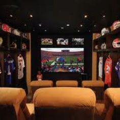 Home theater room with sports memorabilia Home Theater Rooms, Home Theater Design, Cinema Room, Sports Man Cave, Football Man Cave, Watch Football, Football Rooms, Football Fever, College Football