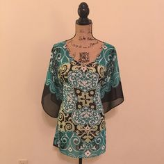 Colorful summer top Light and flows so nicely- such a great lightweight top to wear to the beach. It is a size small, in excellent condition! Chico's Tops Tunics