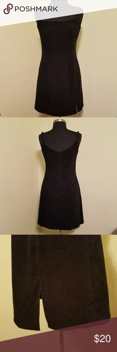 Black Velvet Little Black Dress, 5/6 Every woman needs a little black dress; and this one fits the bill.   Black velvet gives a bit of elegance to this adjustable spaghetti strap dress with slit up side for ease of movement and zipper back.   Never worn but without tags. No flaws. Vintage.  Size 5/6 by Express. Express Dresses Midi