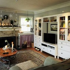 Cozy Ikea living room; two focal points ... the fireplace and the media wall;  fun mantle