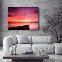 Dramatic extra large art print of the Sea at Dawn. As you wait for the light to appear there is only a hint of what is to come and as the tide went down past the marker in the sea that warns of the jetty, the colours hit the water and all turned to fire.     TITLE:  Fire on the water    READY to HANG!    Created using new Chromoluxe aluminium printing techniques for high quality large art. The colours just sing!    No more sagging canvas, no more breakable glass and expensive heavy frames to…