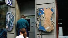 DOs & DON'Ts of travelling in Germany; ATM machine and fragments of Berlin Wall for sale, Checkpoint Charlie.