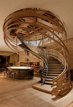 Strips of wood coil around a sweeping staircase at the restaurant of a Strasbourg, France hotel by Jouin Manku. The sculptural stairs bring a modern element to the historic 18th-century space, which formally functioned as the royal stud. A Step Above The Rest: 15 Spectacular Modern Staircases
