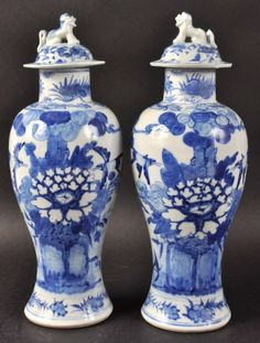 A PAIR OF 19TH CENTURY CHINESE BLUE AND WHITE BALUSTER VASES painted with birds amongst flowering rock. 12.5ins high.