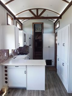 35' Tiny House, gooseneck toy hauler for sale that is fully off grid ready! This beautiful Tiny House has only a few items left to be done (paint touchup and some small trim items) before it is complete. It comes equipped with 12-volt 6 ft slide out in the bedroom with a queen size mattress…
